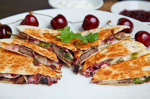 Duck Quesadillas with Chipotle Cherry Salsa and Goat Cheese--Chipotle pan seared duck breast quesadillas with ooey gooey melted goat and jack cheese and a sweet, savoury and spicy cherry salsa.
