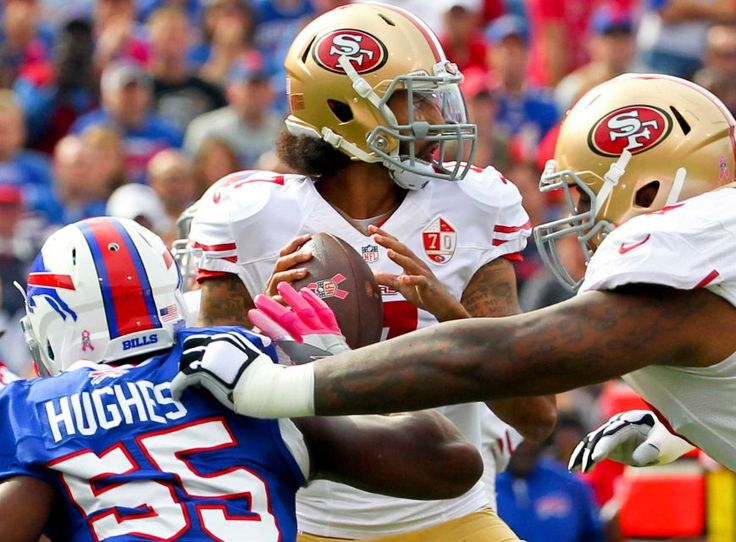 49ers vs. Bills:     October 16, 2016  -  45-16, Bills  -    San Francisco 49ers quarterback Colin Kaepernick (7) passes under pressure from Buffalo Bills outside linebacker Jerry Hughes (55) during the first half of an NFL football game on Sunday, Oct. 16, 2016, in Orchard Park, N.Y.