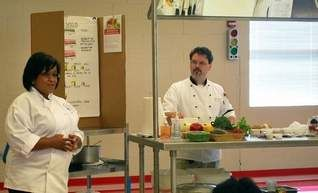Cafeteria staff in the Clinton school district last week underwent training  on how to prepare healthier meals for students. Chef Barry C. Karrh held cooking demonstrations with assistance from Regina Ducksworth (left), the district's child nutrition director. Training was held in the Clinton Park Elementary cafeteria.