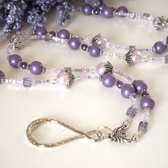 Elegant purple beaded lanyard.