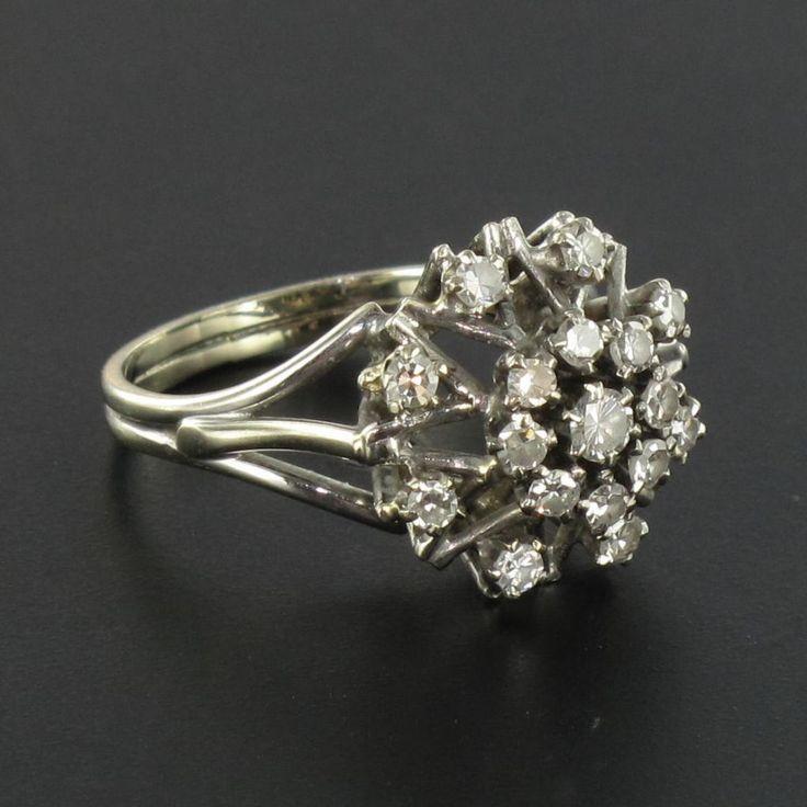 """Bague vintage diamants fiançailles. Surnommée, bague """"chou"""" de part sa forme, fait beaucoup d'effet de part sa corbeille surélevée et la brillance de pierres qui la compose."""