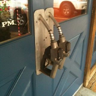 Old petrol taps recycled into door handles. Thanks to Marla Malatak