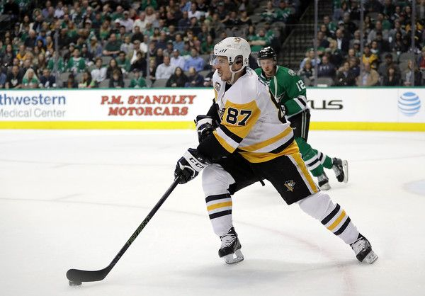 Sidney Crosby Photos Photos - Sidney Crosby #87 of the Pittsburgh Penguins skates the puck against the Dallas Stars in the first period at American Airlines Center on February 28, 2017 in Dallas, Texas. - Pittsburgh Penguins v Dallas Stars