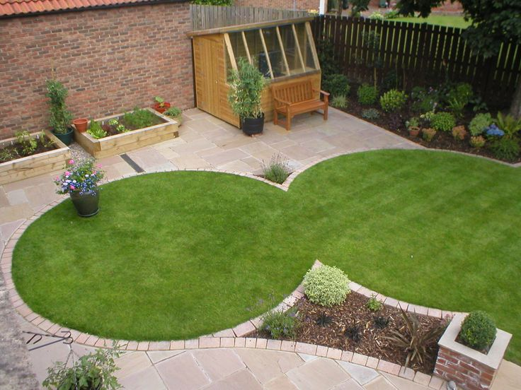 Intersected circle lawns surrounded by patio with angled plantg space. Slanted Windo wall shed in far L corner for sunl