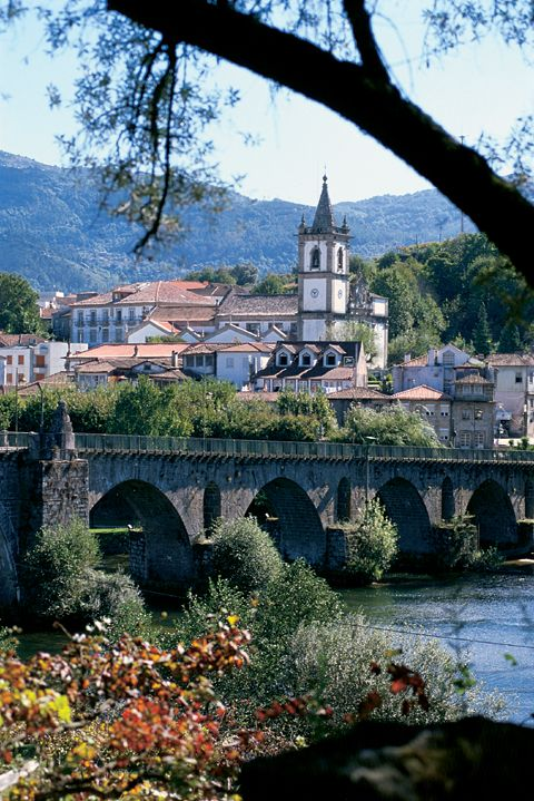 Roman bridge and beatiful church in the beautifull village Ponte da Barca, Portugal