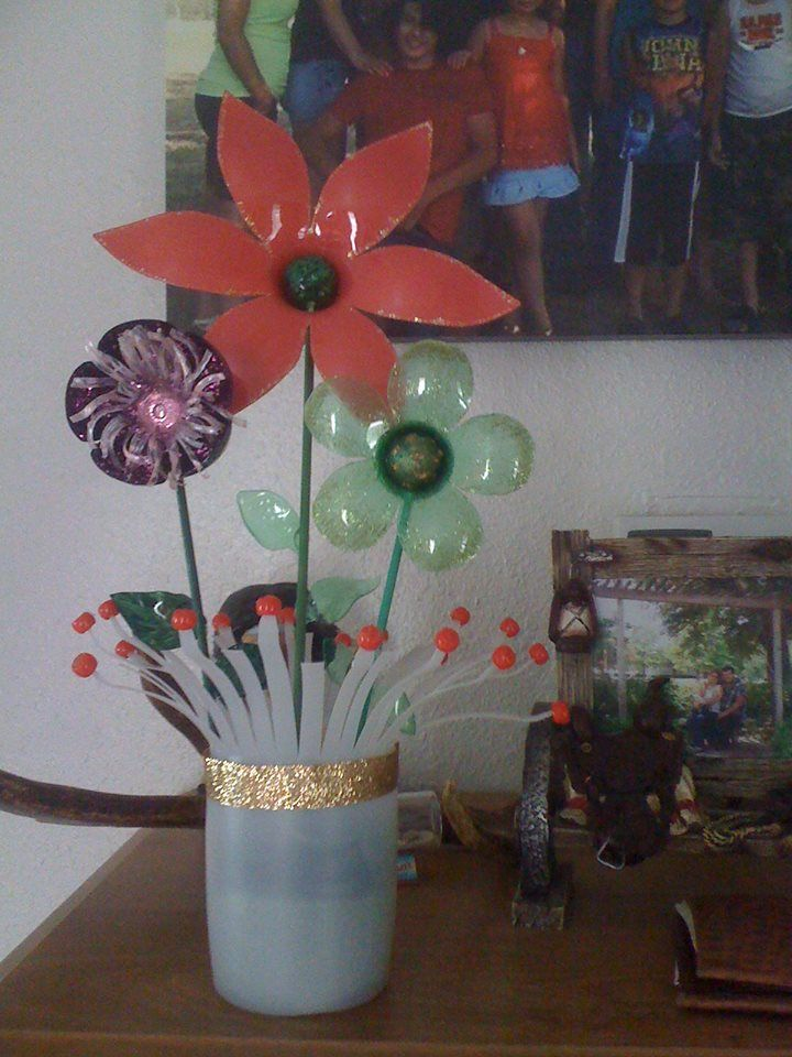 9 best recycled plastic water bottles images on pinterest for Plastic bottle vase craft