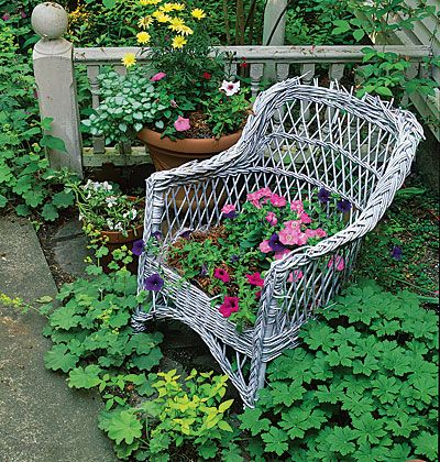 Vintage Planter--There's no rule that says everything in a well-designed garden has to be brand new. As this tattered wicker armchair attests, many of the most charming elements are vintage pieces. Here, petunias form a colorful seat cushion