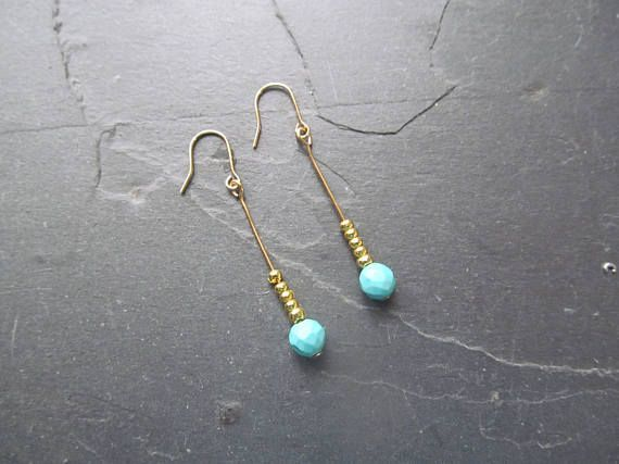 Dainty turquoise and gold earrings with floating turquoise bead. This earring is made from real turquoise beads on a simple delicate gold bar, in a modern minimalist design. Material: gold plated brass  This earring measures approximately 3.5 cm  This item is in-stock and ready to ship
