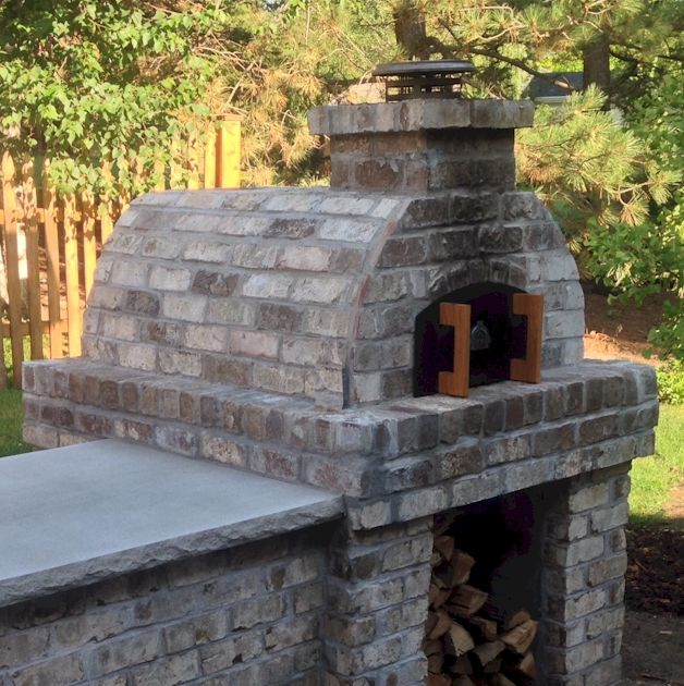 A rustic Wood Fired Pizza Oven is a rustic beauty that was made with the Cortile Barile foam oven forms by BrickWoodOvens.com