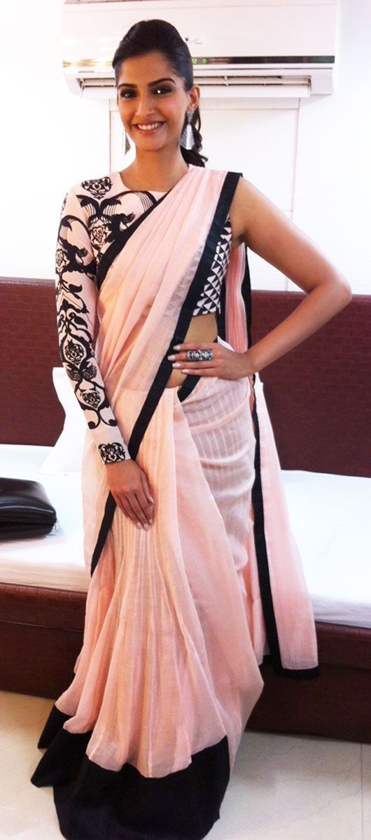 Bollywood's favorite fashionista, Sonam Kapoor in a pink and black Saree by Payal Singhal http://www.payalsinghal.com/ with just one sleeve!