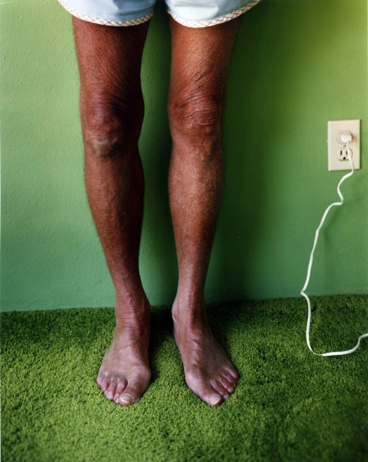 Dad's Legs by Larry Sultan. He takes photographs of his parents in their domesticated home. Sultan manages to simplify some of his shots to show the bare minimum. Notice the lack of clutter and the clean composition.
