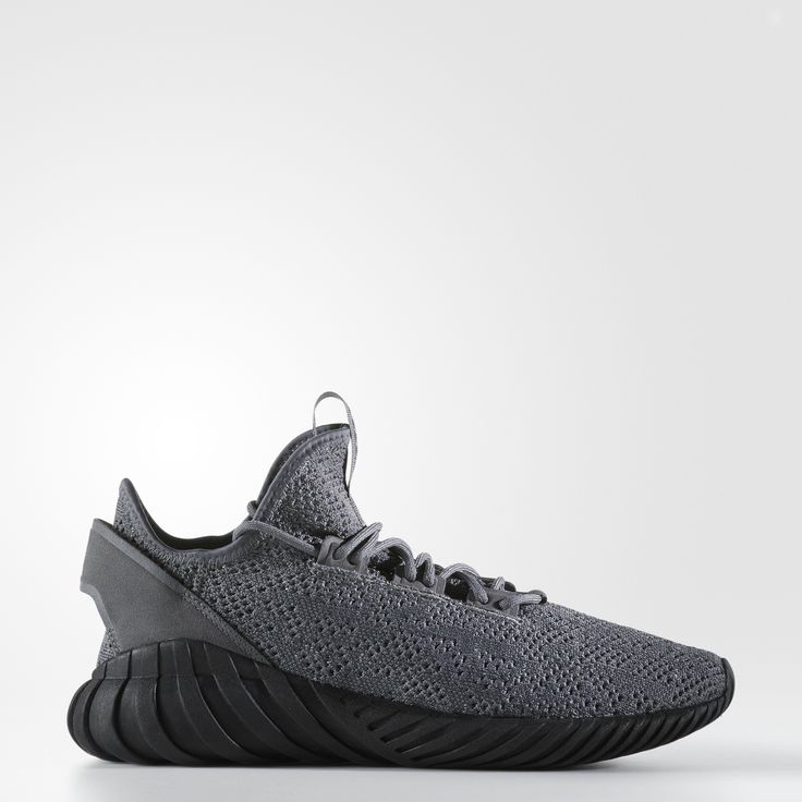 When the Tubular sneaker stepped onto the scene in the '90s, it refused to play by the conventional design rules. Paying homage to the original, the Tubular Doom plays with the innovative archival design and takes it a step further with a new, low-cut angle.   The adidas Primeknit upper wraps around these men's shoes to provide flexible support and lightweight comfort. Riding on the famed Tubular Doom outsole, these modern sneakers are completed with a refined premium suede heel panel...