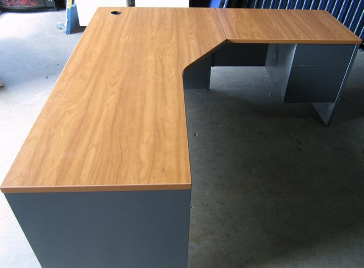 Used L-Shape Desk. Comes in honey cherry laminate. Get a quote today
