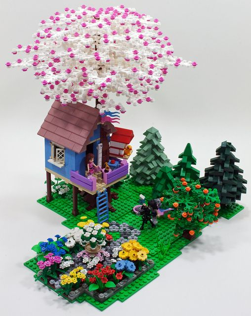 For PennLUG's January 2012 meeting Chris Edwards challenged us to build Friends themed MOCs. I only had Olivia's Tree House and Emma's Fashion Design Studio at the time so my Friends part resources were pretty small. I desided to run with the tree house theme and expand on it adding elements from both sets and a healthy dose of my landscaping knowledge. I think I'm reasonably happy with the results.