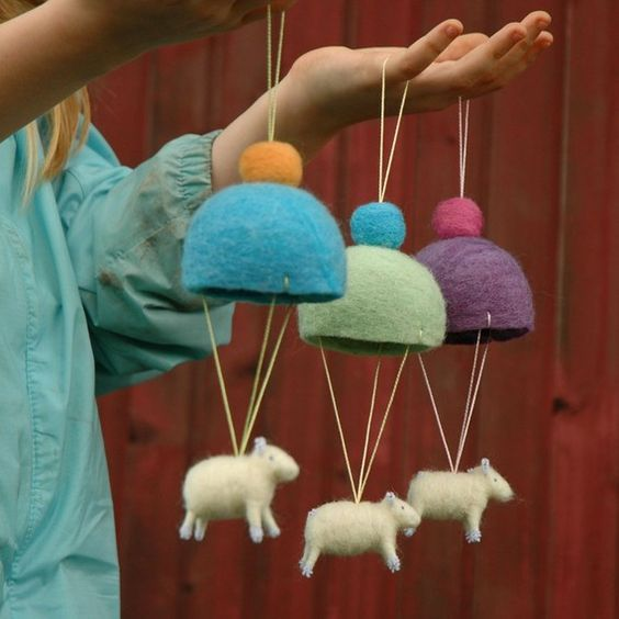 Parachuting lambs, what a cute idea for a baby mobile.: