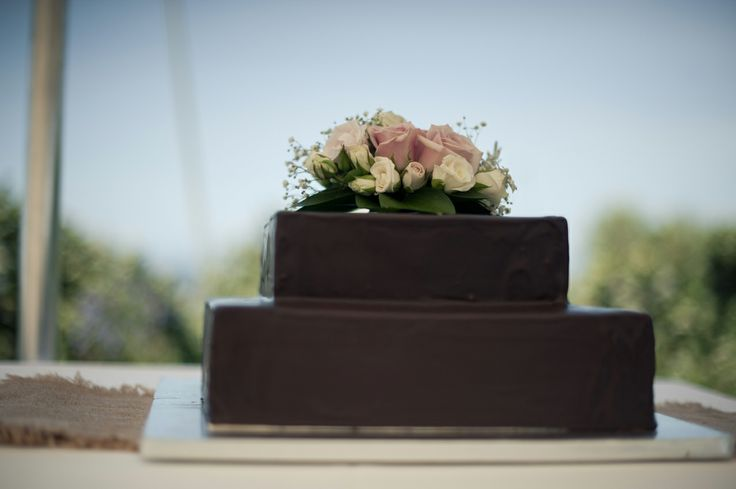 Who doesn't LOVE chocolate - and while we are at it, why not a completely covered in chocolate wedding cake! Wedding co-ordinated by Waiheke Island Weddings and Events.