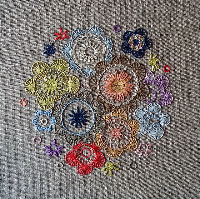 Flower circles Stitched on 32-count linen using split stitch, buttonhole stitch, backstitch, laisy daisy (detached chain) stitch, coral stitch. Stitched with DMC stranded cotton and linen flosses.