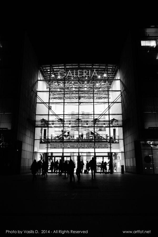 Figures at Galeria Krakowska by Vasilis D.  #mall #night #blackandwhitephotography #urban