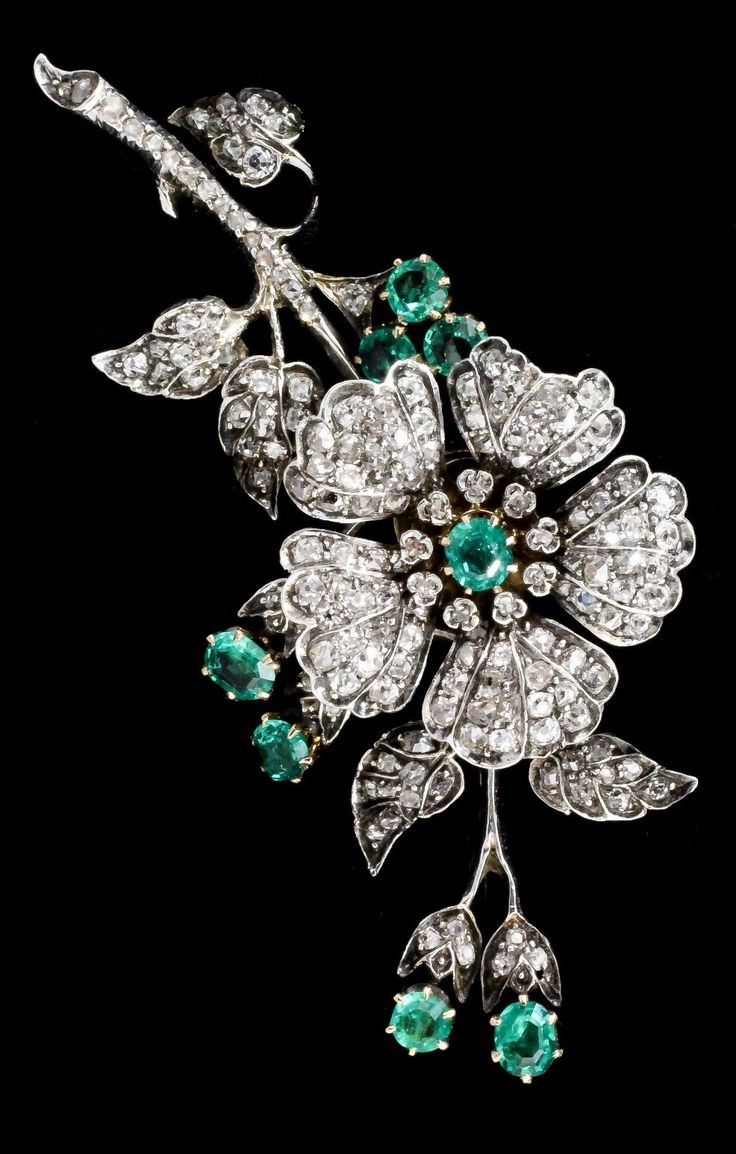"""A late Victorian gold and silvery coloured metal mounted emerald and diamond set flower pattern brooch """"En Tremblant"""", set with one hundred and sixty-five small rose cut diamonds (estimated diamond weight 6.1ct), and eight circular emeralds, each approximately .33ct, 80mm x 40mm. #Victorian"""