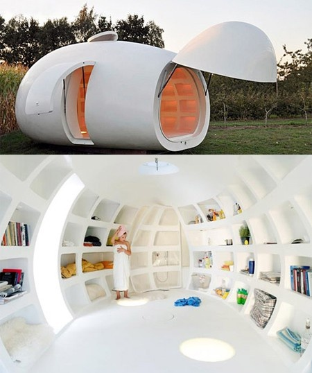 """This egg shaped guest house was designed by Belgian architectural firm dmvA. """"http://www.dmva-architecten.be/"""" It includes a bathroom, lighting, a bed and several niches for storage. It can also be used as an office and is easily transportable."""