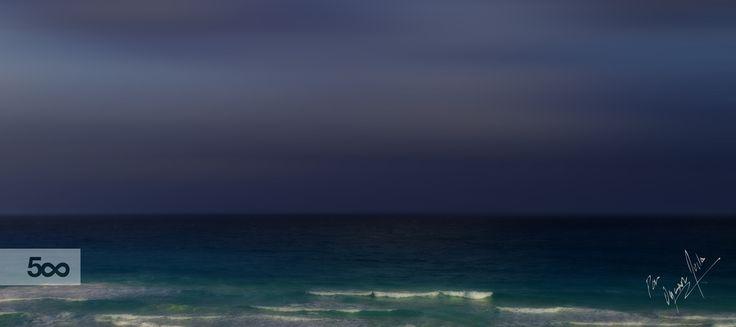 Vista al mar en la noche de Cancún