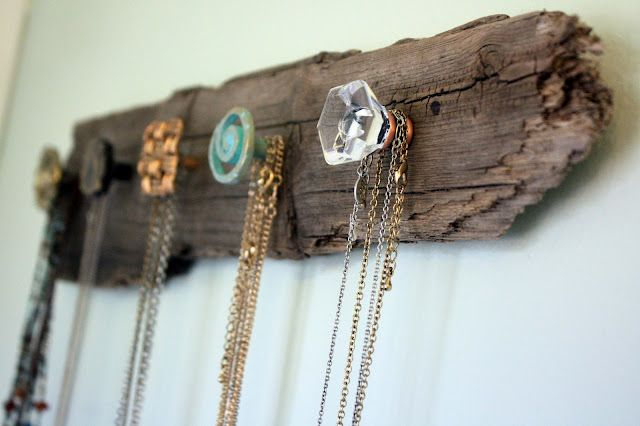 interesting knobs on old wooden planks to hold jewelry. Like.
