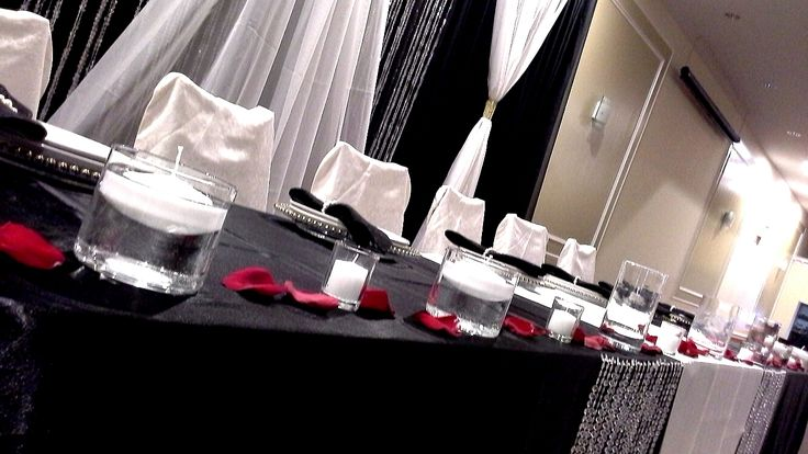 head table and backdrop decor with hanging crystals and floating candles; design by Davis Floral Creations