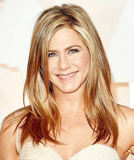 "To complement Aniston's Atelier Versace dress, Living Proof hair pro Chris McMillan went for ""very natural, sexy, and glamorous hair. The inspiration was to be comfortable so that she could enjoy her time."" After washing her hair with Living Proof No Frizz Shampoo and Conditioner, McMillan used the brand's Blowout at the roots. He then blew her hair out with a slight side part before finishing with a bit of Satin Hair Serum to the ends to combat frizz."