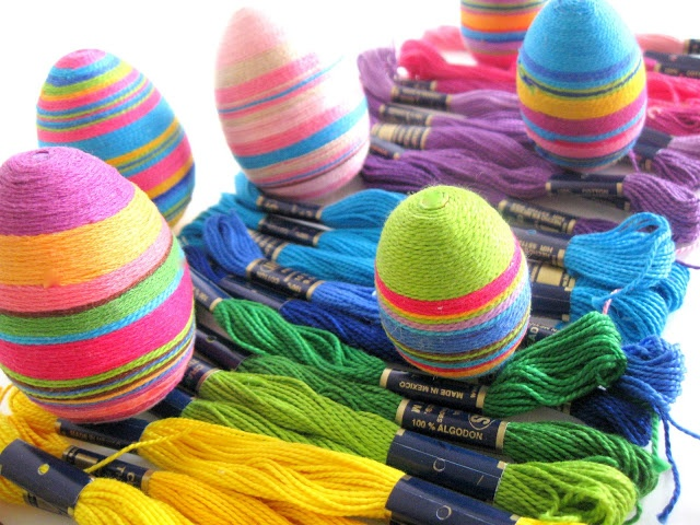 Styrofoam egg + embroidery yarn + glue = awesome eggs.