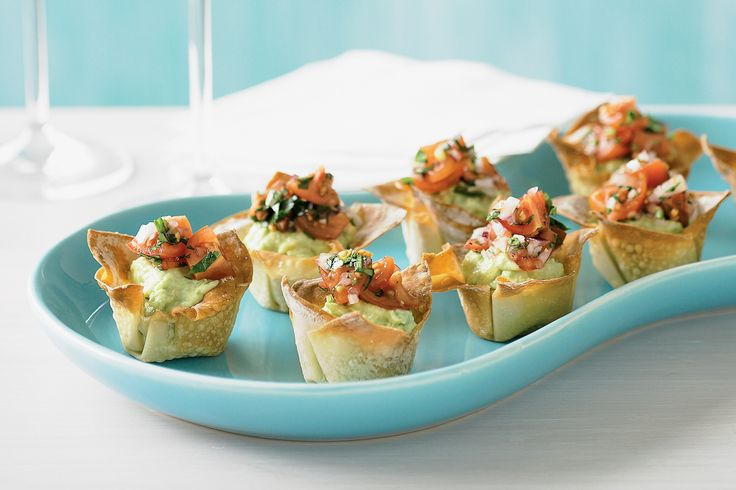 These avocado and cherry tomato bites are sophisticated cockail party food fare.