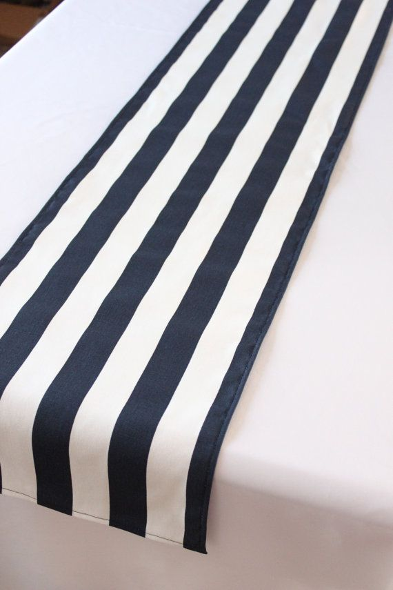 This navy blue and white striped table runner is the perfect compliment to your décor! It has rectangular ends and all edges are hemmed (not serged)