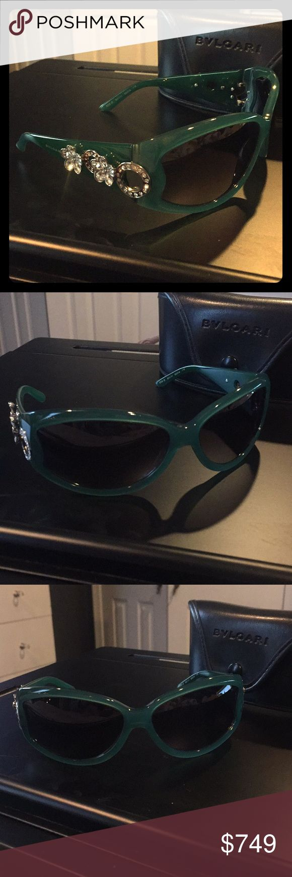 Bvlgari Swarovski Crystal Flower  RARE -Jade Green Authentic bvlgari Swarovski sunglasses. Black lenses (no scratches) with Jade Green color frames.  Wide acetate arms are embellished with Swarovski crystal flowers - no crystals missing. Mint condition item. Will include original case ( has a small white scuff on case on back) purchased at Optica in the Mandalay Bay in Las Vegas in 2006 bvlgari Accessories Sunglasses