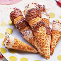 Chocolate- and Candy-Coated Waffle Cones. recipe for homemade cones (you need a pizelle iron). dip in choc and fill with ice cream.