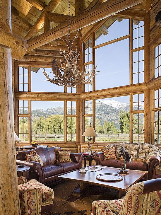 Teton Heritage Builders, Custom Log Home. Designer: Laurie Waterhouse Interiors. Stunning log home great room!
