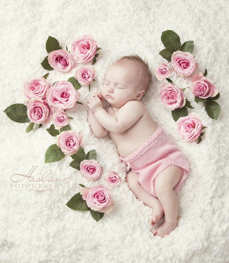 Roses and baby forming a heart.