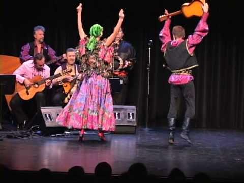 "Dancers Andrij Cybyk and Ganna Makarova performing Russian Gypsy favorite ""Two Guitars"".    Mikhail Smirnov (guitar, vocal), Alex Siniavski (Gypsy guitar), Sergey Ryabtsev (violin), Gennady Gutkin (bayan), Leonid Bruk (balalaika-contrabass), Lev Zabeginsky (balalaika), Vasiliy Romani (Russian Gypsy 7-stringed guitar).    Russian dance and music ..."