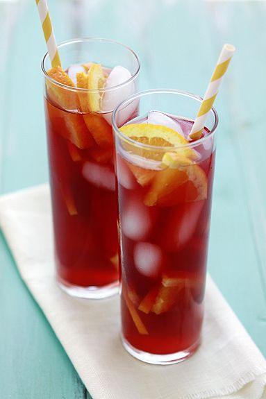 tangerine raspberry iced tea (herbal)  6 cups water  5 Tangerine herbal tea bags  4 Raspberry herbal tea bags  1 - 1 1/2 cup Pomegranate juice (or according to your tastes)  orange or tangerine slices, optional garnish  raspberries, optional garnish  ice cubes