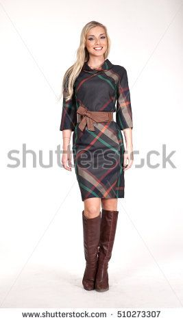 blond european business executive woman in wool dress and high heel boots. full length body portrait isolated on white