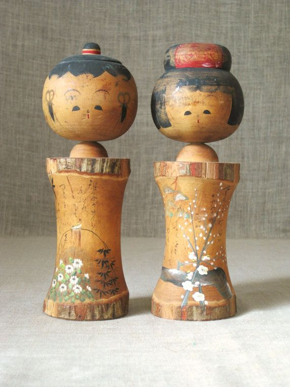 These are 2 very cute Vintage Japanese Kokeshi Dolls. I love these dolls, this is definitely an older pair of these charming dolls. These are so