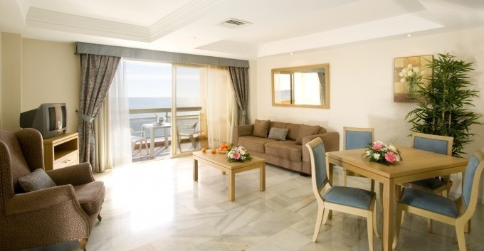 Sunset Beach Club hotel is a four star holiday resort, located beachfront in Benalmadena, on the Costa del Sol, Southern Spain.    Completely renovated, the hotel offers 552 elegant and modern hotel apartments, suitable for up to four persons, most with one bedroom and all with their own kitchen, lounge-diner and balcony. Our elegant hotel-apartments combine the convenience and value of self-catering with the luxury facilities and services of a four star hotel, all year round.