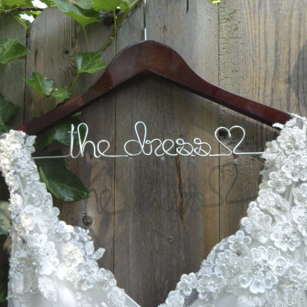 A custom wedding dress hanger is the perfect way to show off your gorgeous gown in your wedding photos! Made using a sturdy wooden hanger with carved notches to help prevent slippage of your delicate