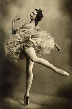 Vintage ballet dancer standing en pointe-- eh eh her ankles are bare!!