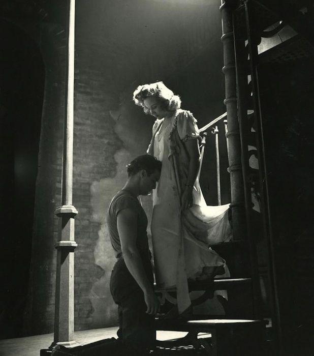 A Streetcar Named Desire, Marlon Brando kneeling before Kim Hunter. Photo by Eliot Elisofon, 1947.