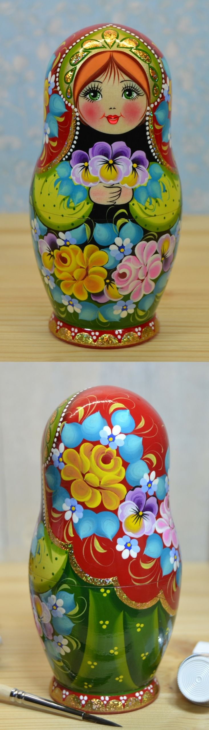Wooden nesting doll in floral costume, made by artist Nadezhda Tihonovich. Find more lovely russian matryoshka dolls at: www.bestrussiandolls.etsy.com
