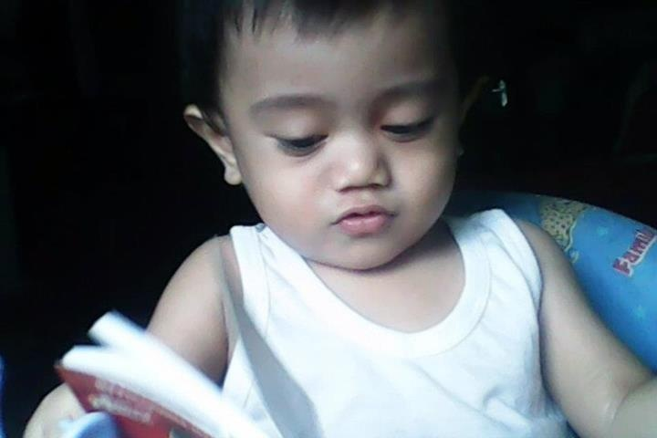 "Baby-Jo ""reading"" a book... ;)"