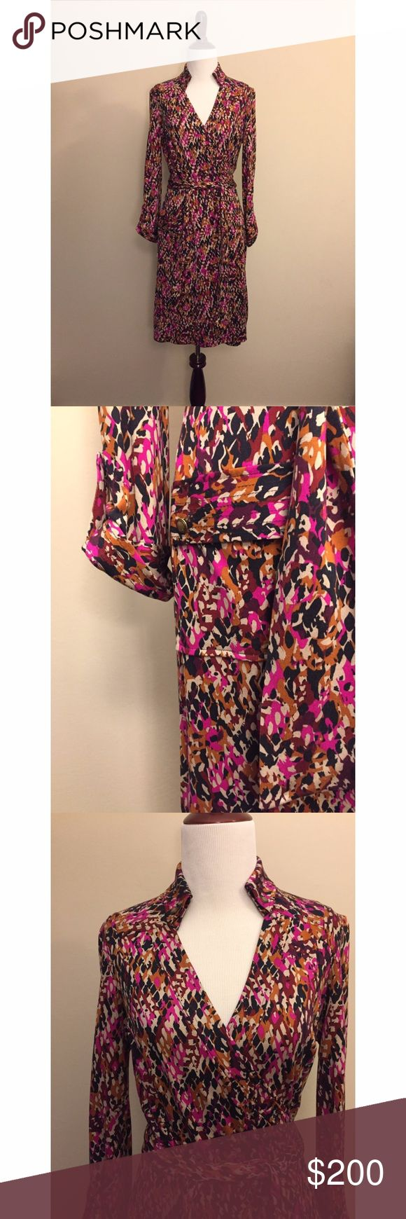 """Diane von Furstenberg Konya Wrap Dress Size 8 An iconic DVF style, this camouflage silk-jersey wrap dress features a waist tie and button-flap hip pockets. Buttons secure fold-over collar and button-tab detail gathers cuffs. Quilting at yoke and quilted banding at pockets and cuffs. 3/4 sleeves can be worn cuffed or long.  * 37"""" long, measured from center back. * Fabrication: Silk jersey. * 100% silk. * Dry clean. * Imported. Diane Von Furstenberg Dresses Midi"""