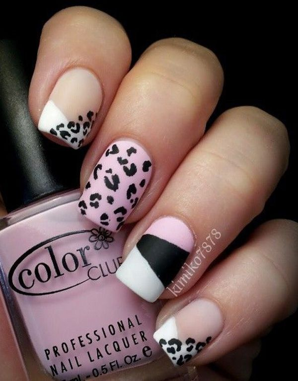Black and white inspired leopard nail art design. This black and white combination also sports a bit of pastel pink into the roster and they all blend well to form a unique French tip of leopard prints.