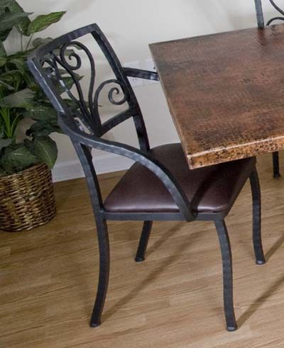 Forged Iron Arm Chair 261 Western Dining Chairs - Hand forged iron arm chair with symetrical scroll design and chocolate brown leather seat. The black iron is blacksmith built and every hammer blow brings a specific signature of the craftsman. Chair is also available in armless style.