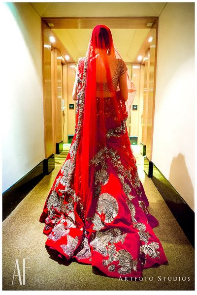 Manish Malhotra bridal lehenga , red bridal lehenga , red and gold bridal lehenga, red and silver lehenga , bridal lehenga with train