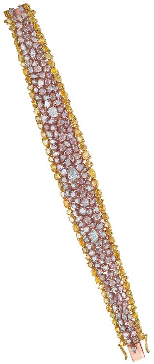 How drop-dead gorgeous is this diamond, pink diamond, and yellow diamond bracelet?? The three colors of stones are set in three colors of gold: 18K rose, yellow, and white. (Via Phillips.)